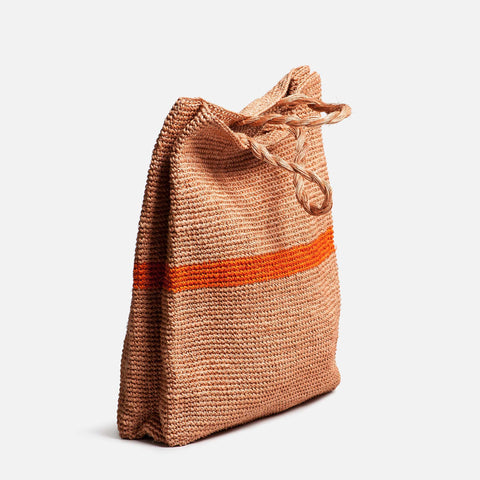 Solid and Sustainable handwoven market bag with twisted handles (side view)