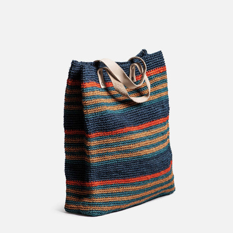 Solid and Sustainable handwoven market bag with leather handles (side view)