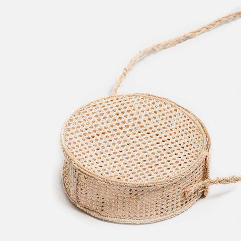 Solid and sustainable handmade straw circle crossbody bag (laying down)