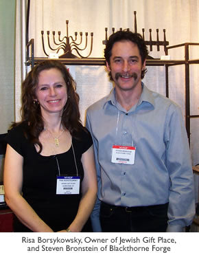 Risa Borsykowsky, Owner of Jewish Gift Place, and Steven Bronstein of Blackthorne Forge