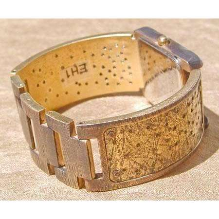 Eduardo Milieris Cloister Watch: Brass Perforated Trim on Wide Band