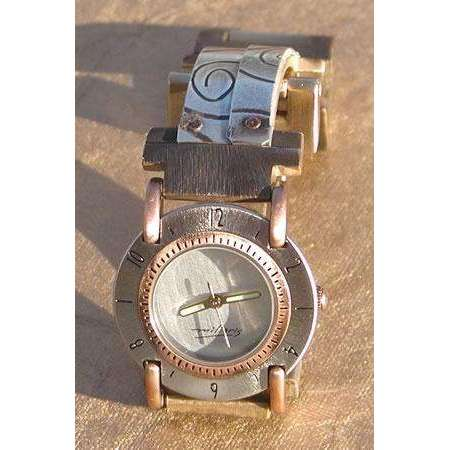 Eduardo Milieris Full Moon Watch: Small Silver Overlap Spiral Design on Narrow Band