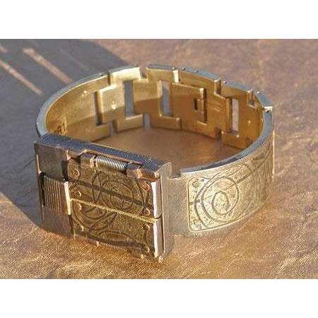 Eduardo Milieris Gates of Time Watch: Brass Spirals & Stripes on Wide Band