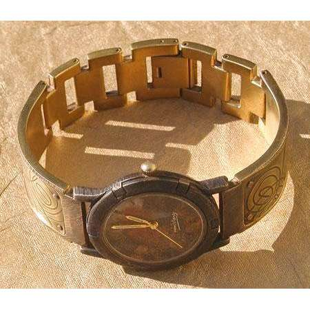 Eduardo Milieris Porthole Watch: Large Brass Spirals Design on Wide Band