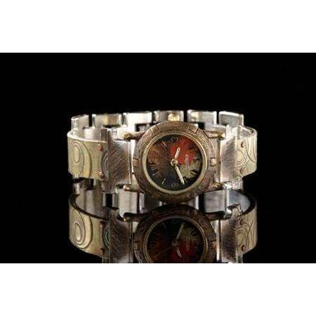 Eduardo Milieris Porthole Watch: Small Brass Spirals Design on Narrow Band