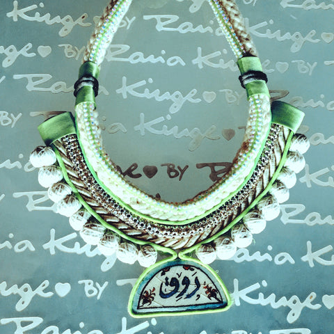 Ishani necklace, made with ishani, a caligraphy hand painted enamel porcelain trafitionaly made in Damascus. Made with love by displaced women in Syria.