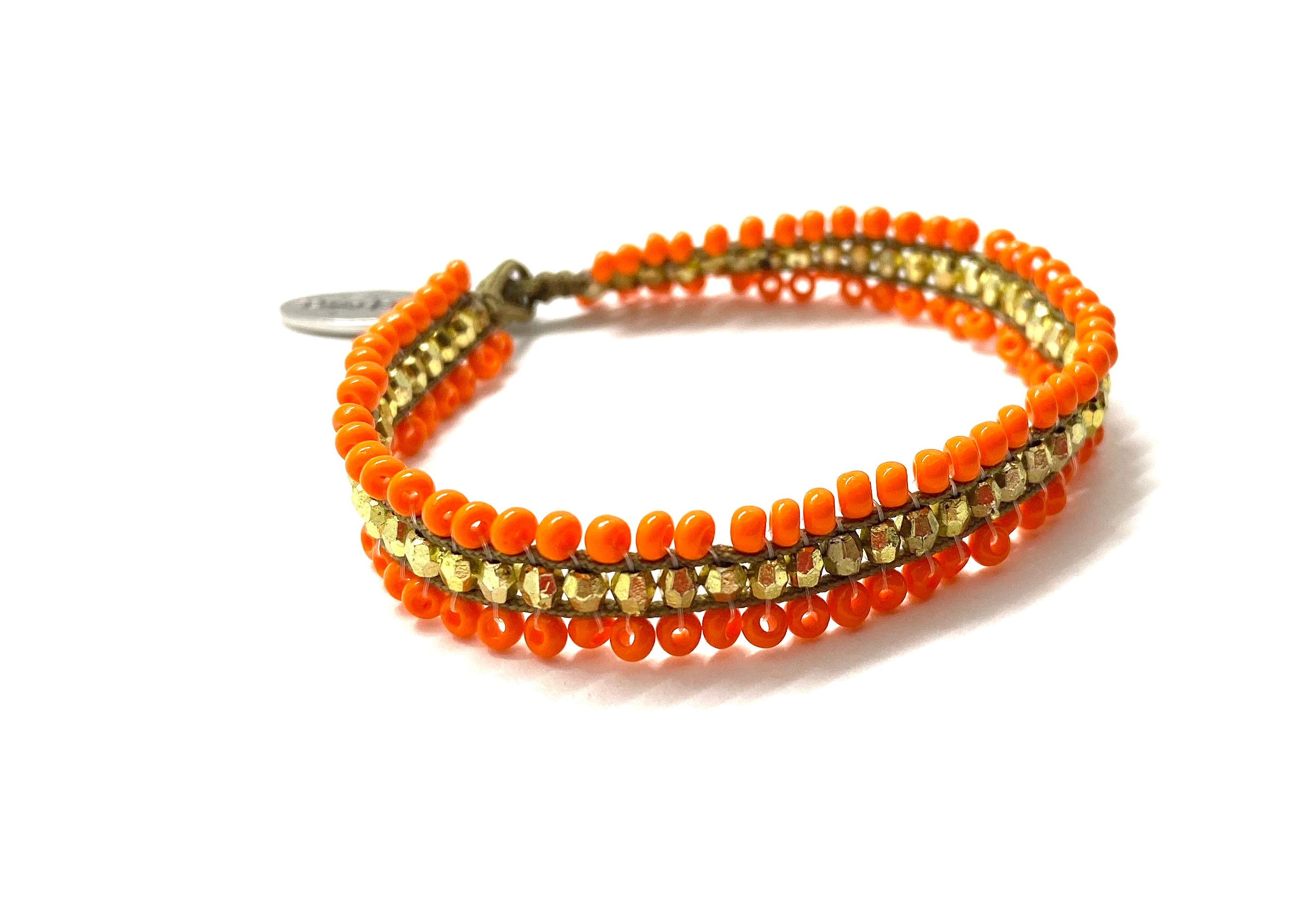 Beaded bracelet, orange and gold sequence