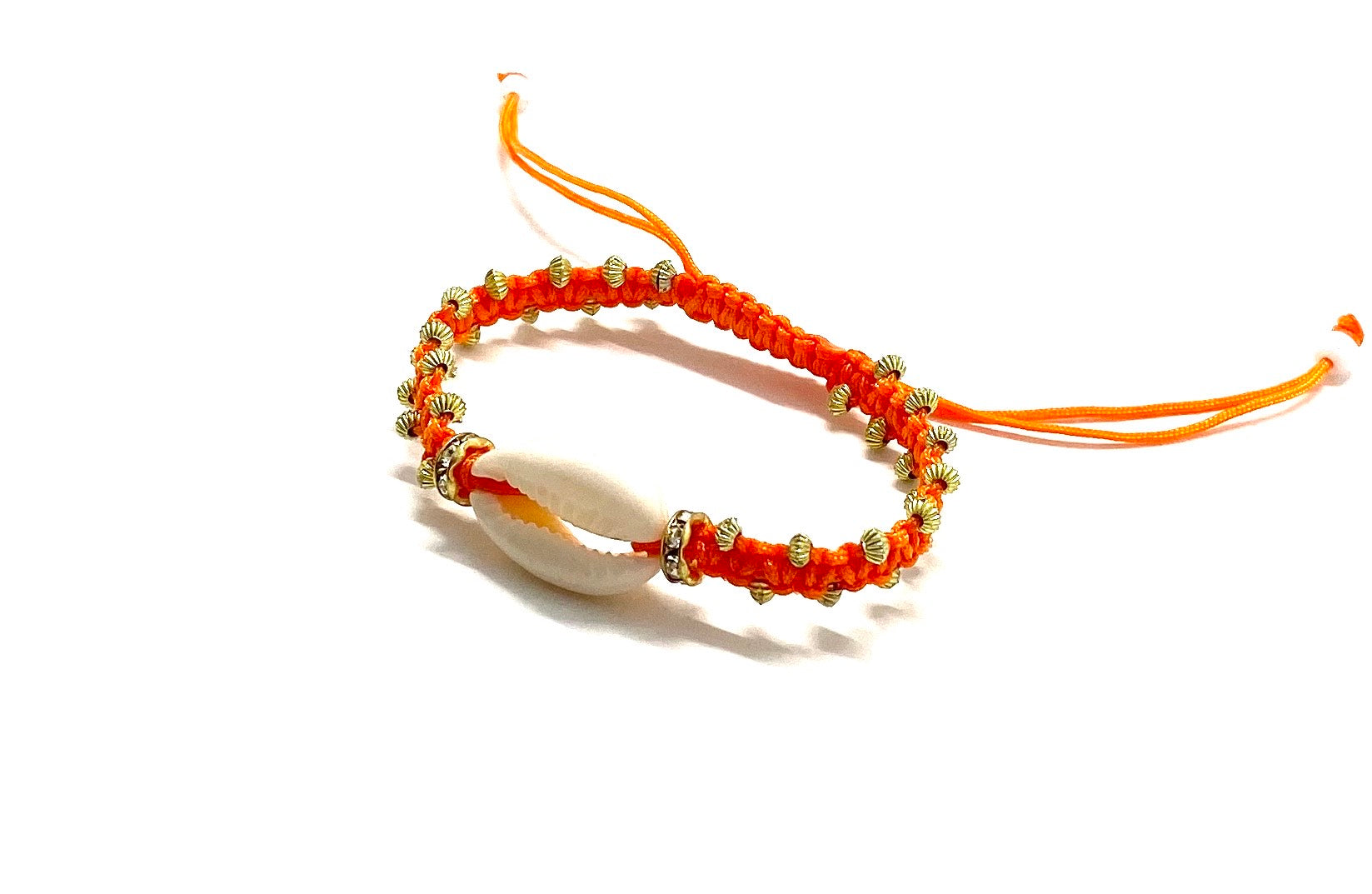 Natural shell bracelet with gold toupee on orange braided cord