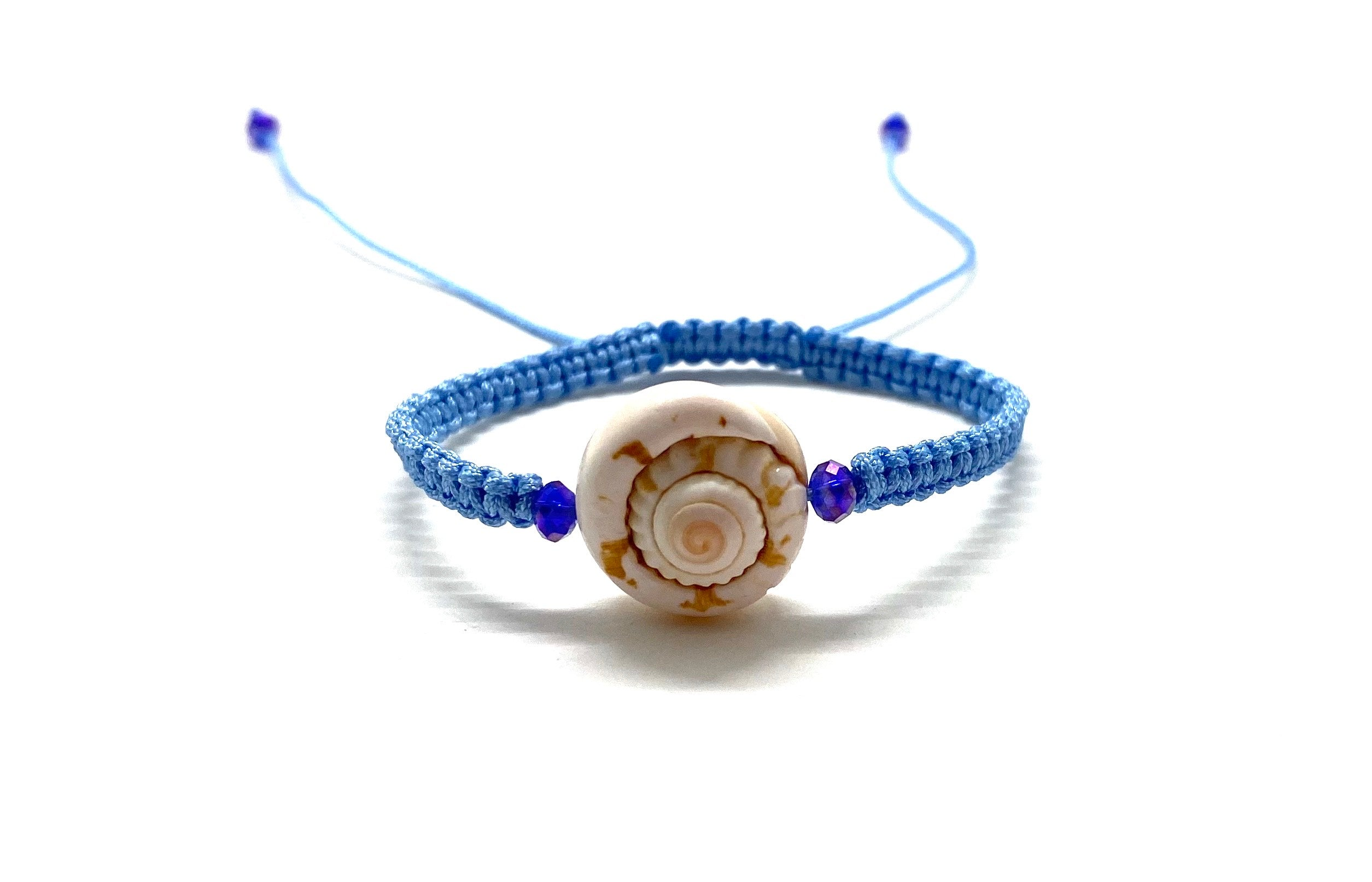 Seashell bracelet, purple Swarovski beads baby blue braided cord