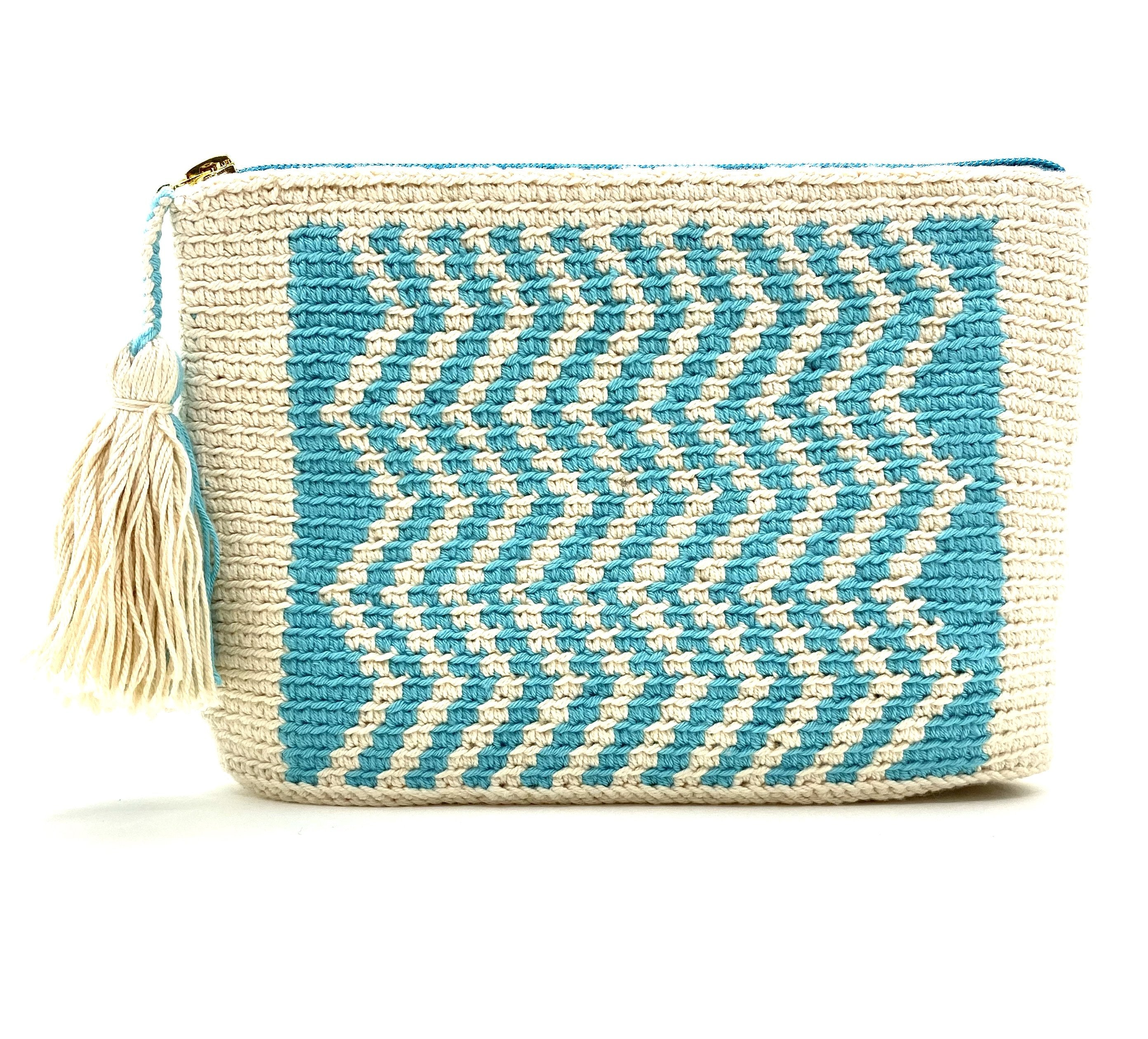 Clutch with turquoise blue waves, off white body with turquoise and off white tassel.
