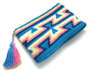 Clutch with sky blue body, sky blue inverted triangles, navy blue, pink, yellow, white, sequence, and tassel
