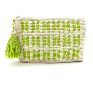 Clutch with off white body, lime green butterfly pattern and a tassel