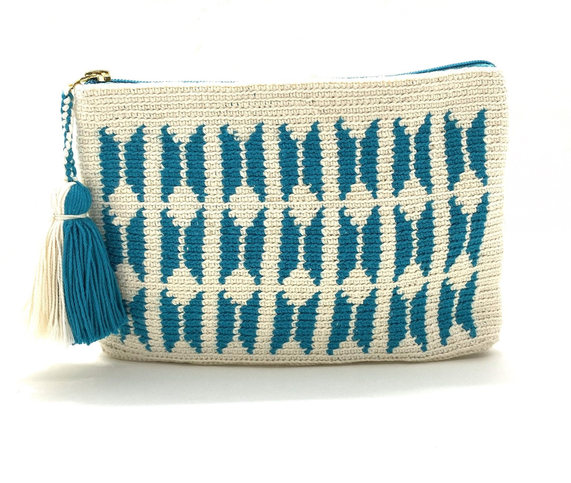 Clutch with off white body, teal butterfly pattern and a tassel