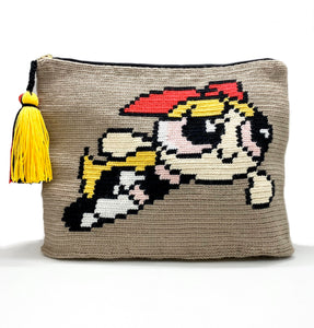 Clutch with beige body, Blossom the Powerpuff Girl and a yellow, black, and red tassel