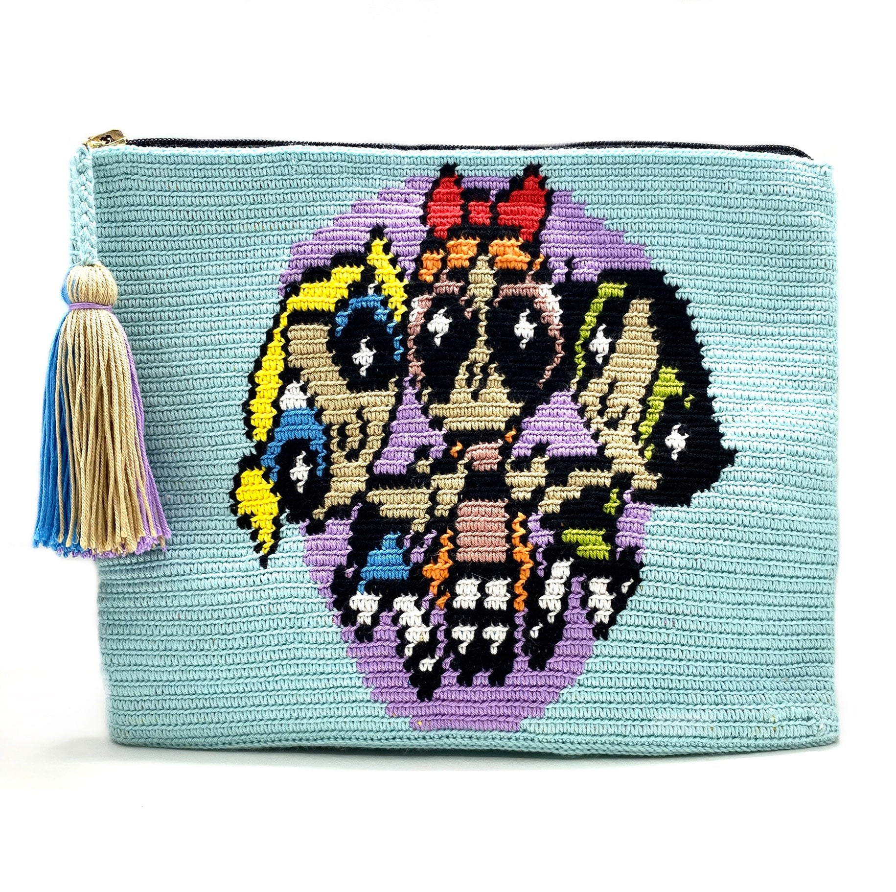 Clutch with baby blue body, the Powerpuff Girls, lavender circle and a lavender, beige, and sky blue tassel