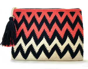 Clutch with half off white half coral body, black zigzag sequence and a tassel
