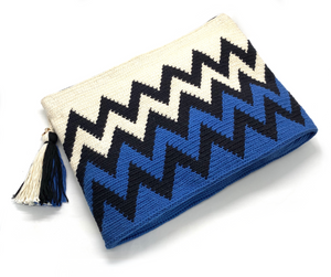 Black zigzag sequence, half cream and half electric blue clutch, with tassel.
