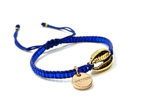 Gold Shell bracelet, with shiny blue seed beads and blue cord.