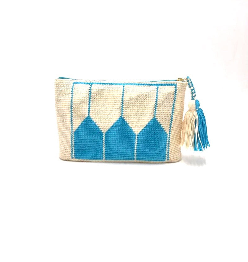 Clutch, off white body, blue temple pattern with tassel.