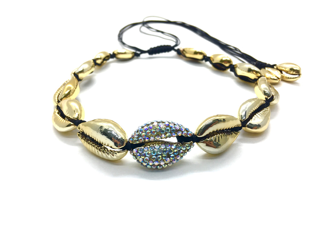 Gold shell necklace, with Swarovski studded central shell, and black cord