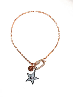 Clip to impact, rose gold chain with grey star.