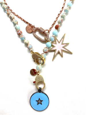 Aqua Gaia necklace, with round blue star pendant, gold zirconia clips