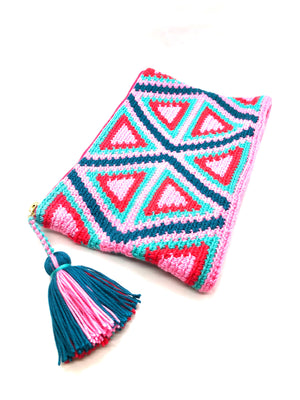 Clutch, with red, pink, turquoise and petrol triangle pattern with tassel.