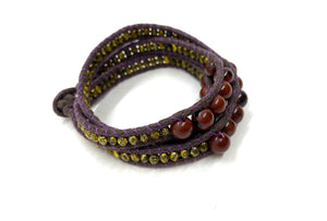 Wraparound brown bead bracelet, dark brown cord pale gold resin side bead.