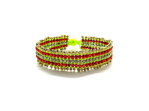 Beaded bracelet, gold and red beads fluo green cord.