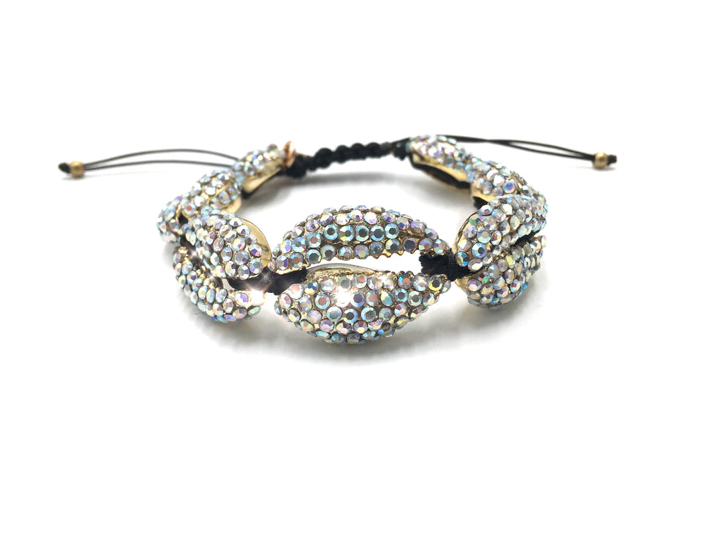 Gold shell bracelet crystallized in Swarovski, black cord.