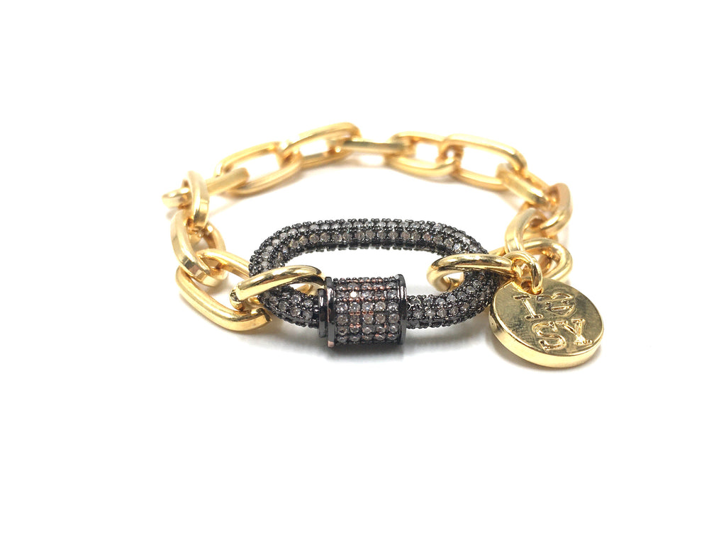 Clip2impact gold chain bracelet with black zirconia clip.