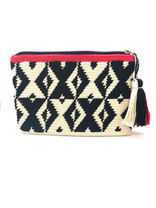 X pattern clutch, black and cream with red trim and tassel.
