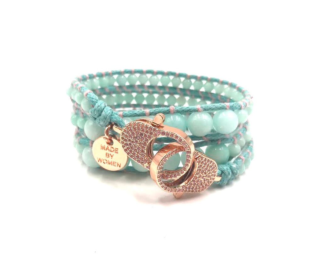 Clip to impact aqua blue bracelet with rose gold clips.