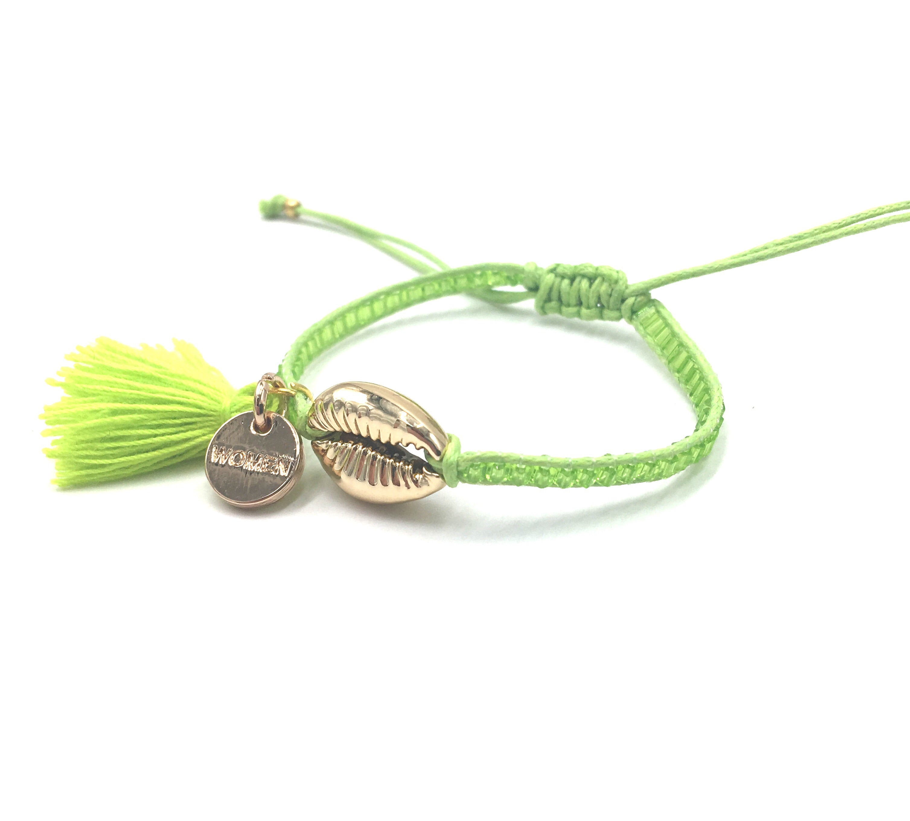Gold Shell bracelet, kiwi green beads and tassel.