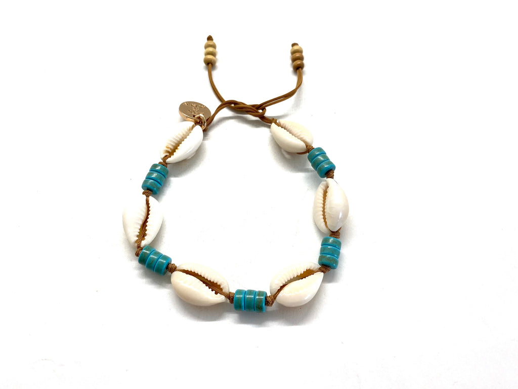Natural shell anklet with 'rondelle'.