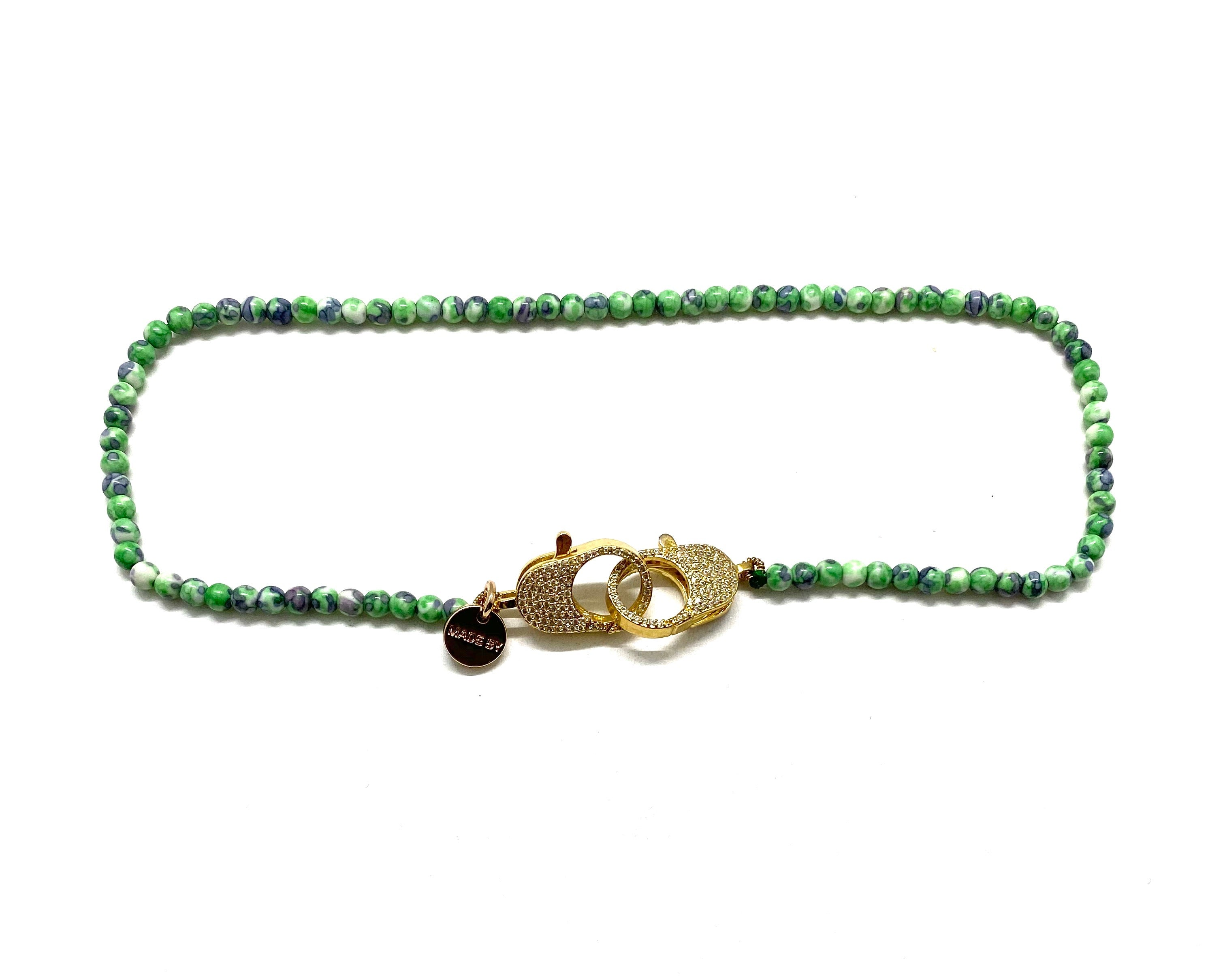 Clip to impact Green rainbow stone Christine necklace.