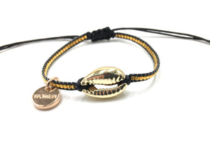 Gold shell bracelet, with gold Miyuki beads, and black cord.