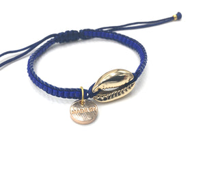 Gold Shell bracelet, mat blue seed beads and dark blue cord.