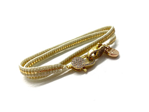 Cream miyuki bracelet, gold sequence and clips