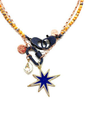 Rose gold chain, dark blue studded clip and blue star