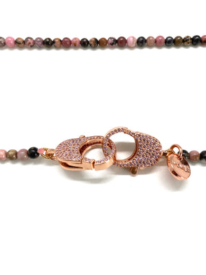 Clip to impact, lace rhodonite round stone with rose gold zirconia studded clasp.