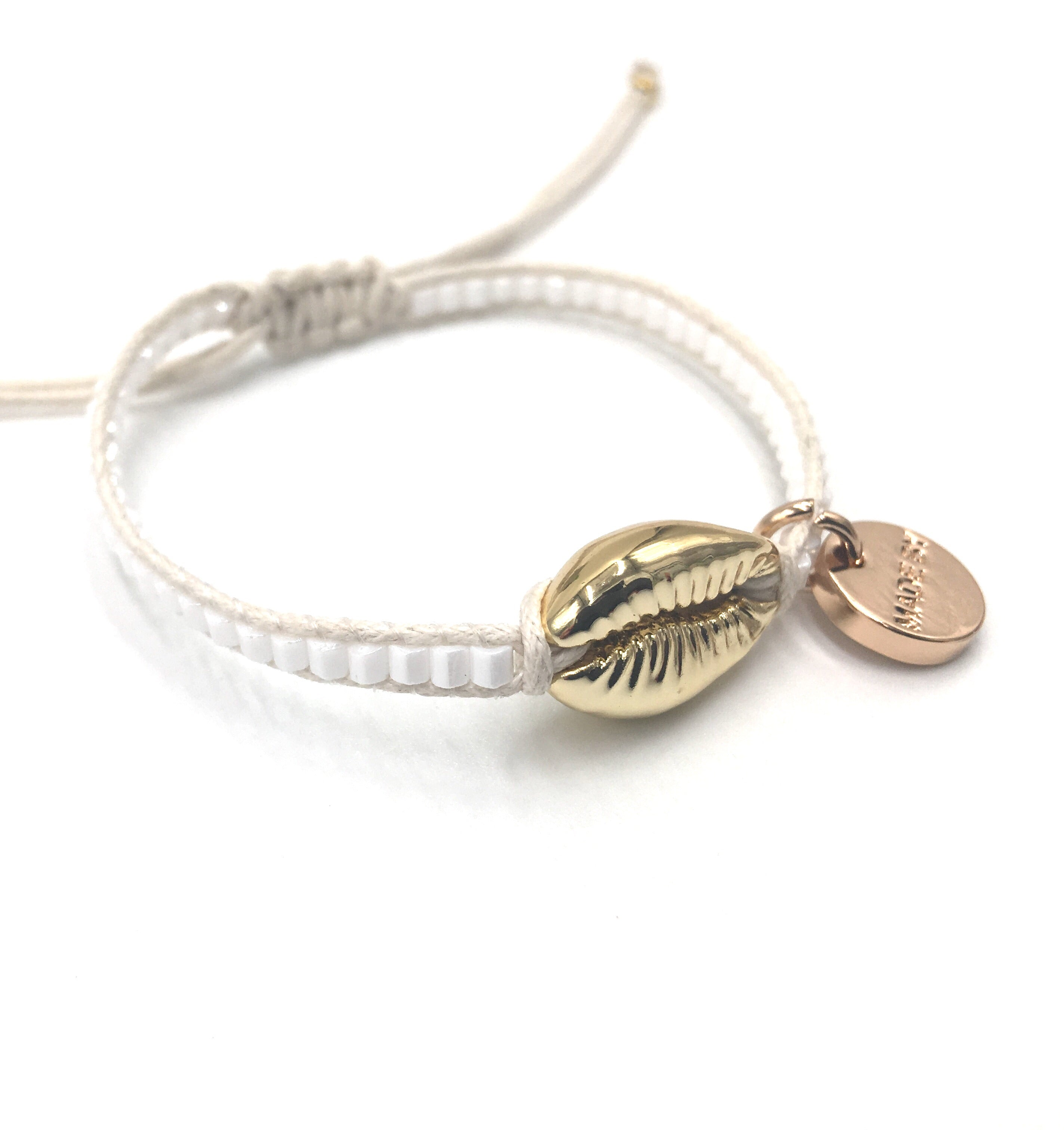 Gold Shell bracelet, white seed beads, offwhite cord