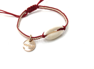Natural shell bracelet, cream mIyuki and dark red cord.