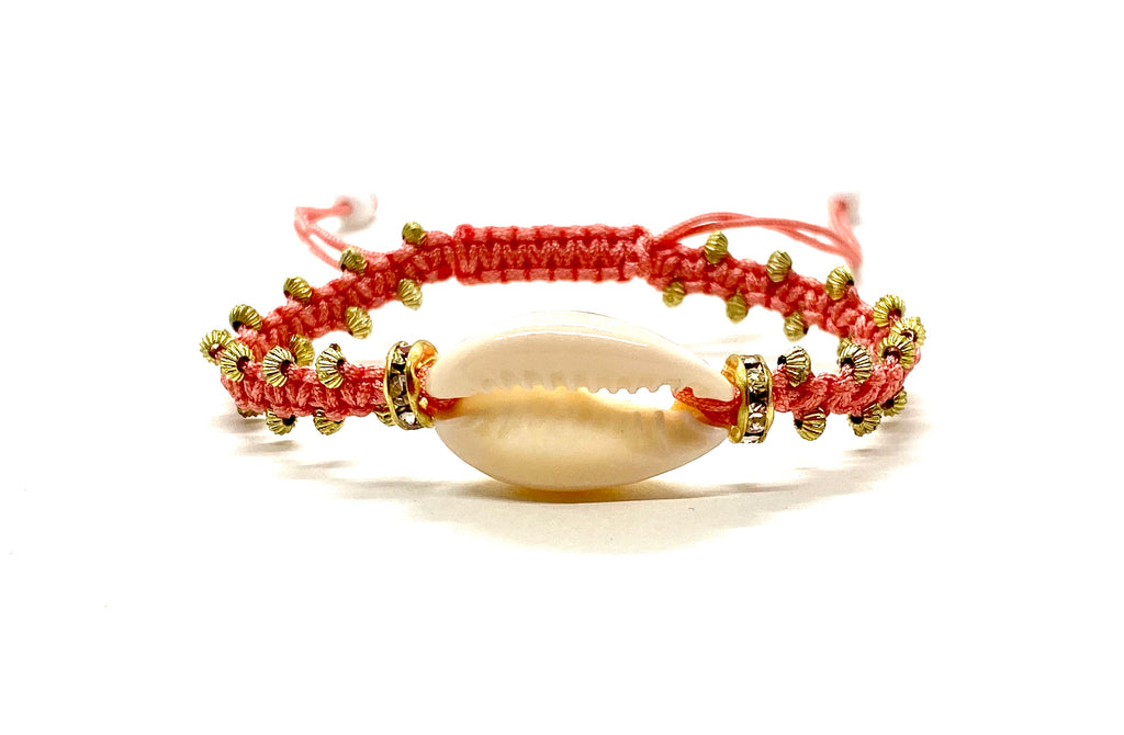 Natural shell bracelet with coral cord and gold resin beads.