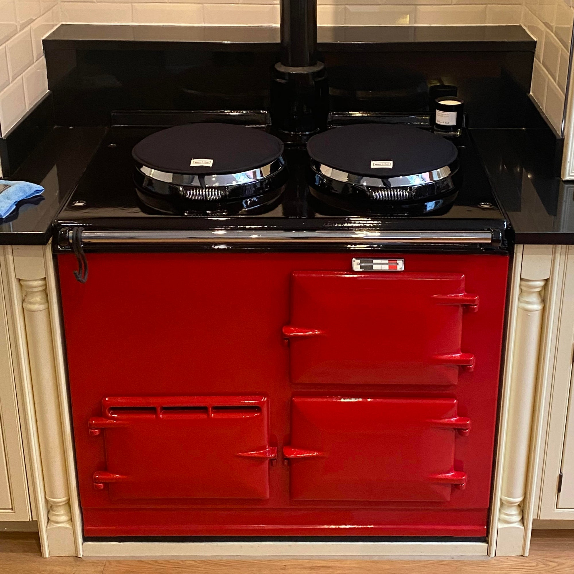 A two oven Aga range cooker re-enamelled from cream to pillar box red!