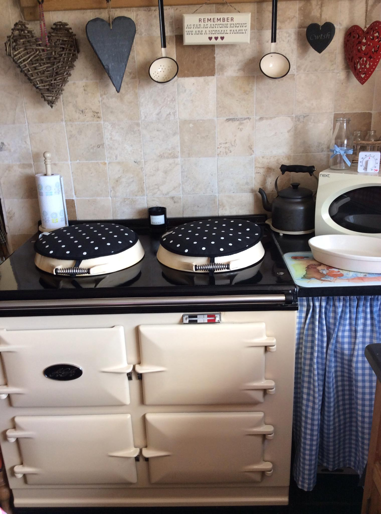 2 oven Aga in cream with 'Dotty' hob covers by Blake & Bull