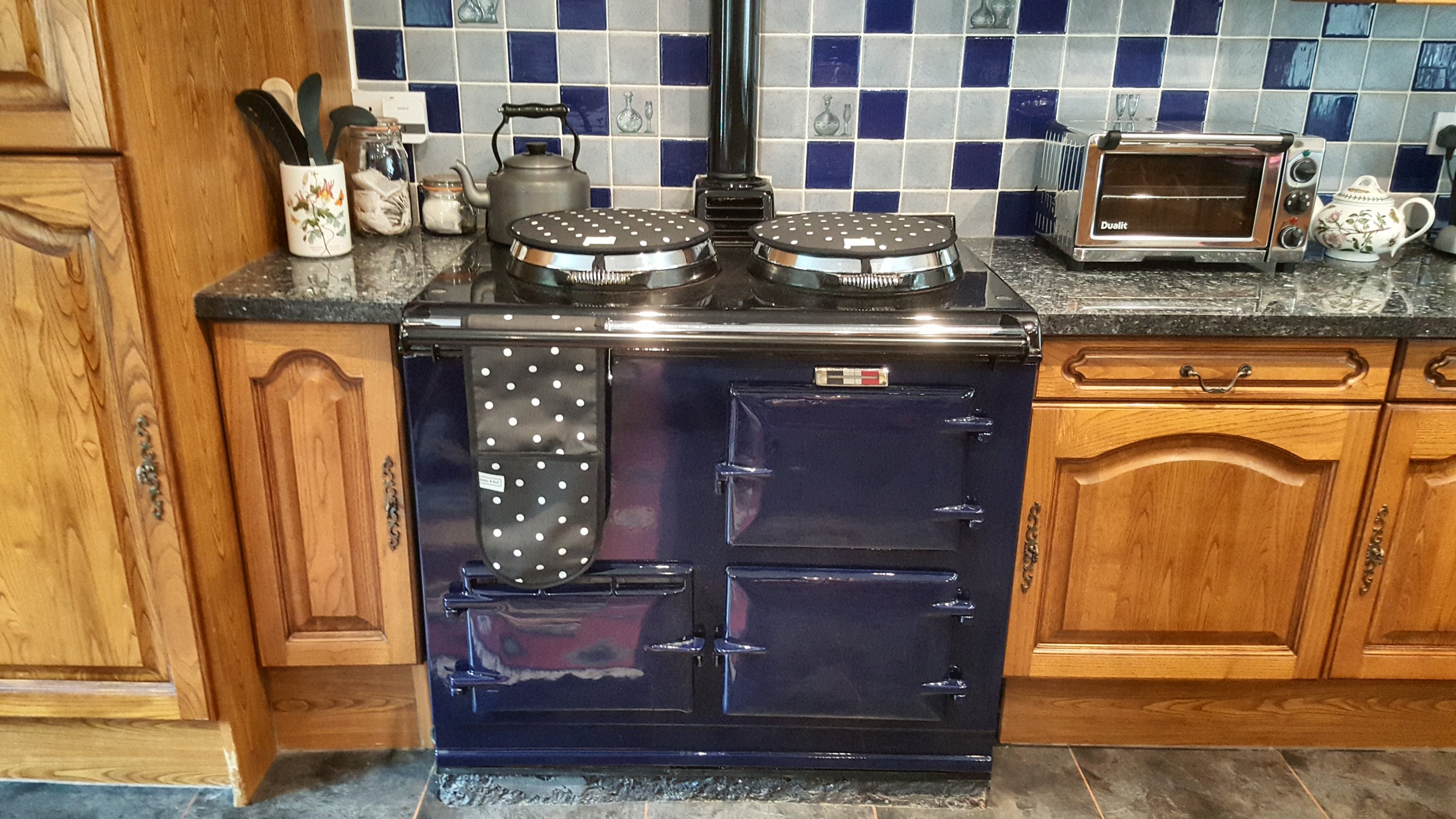 Blue Aga range cooker in wood kitchen