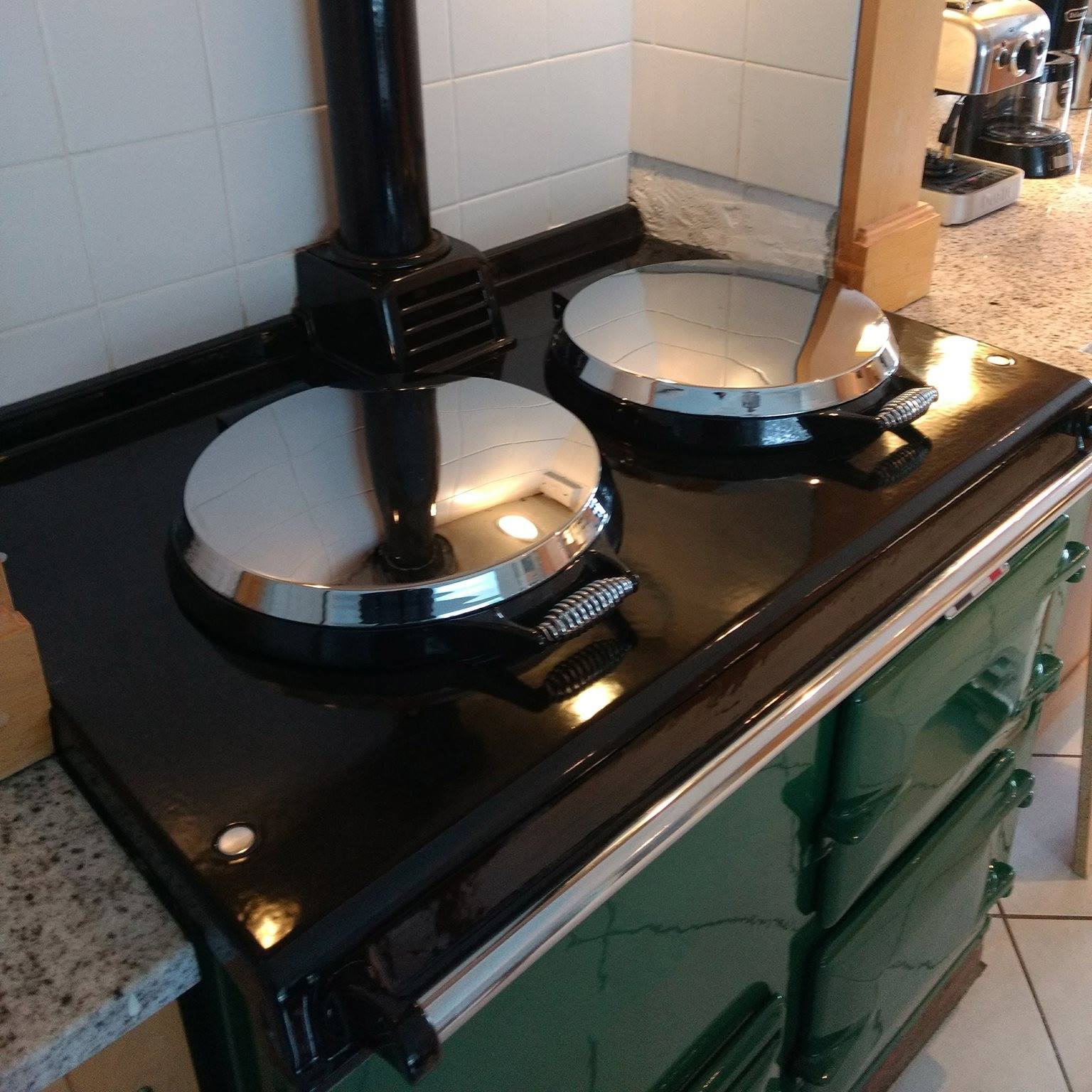 Green re-enamelled Aga range cooker with lids down