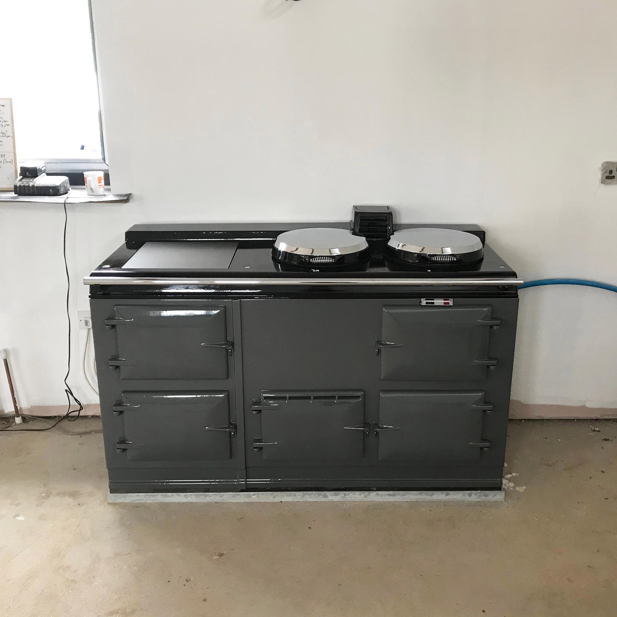A clean and tidy work site around grey Aga range cooker