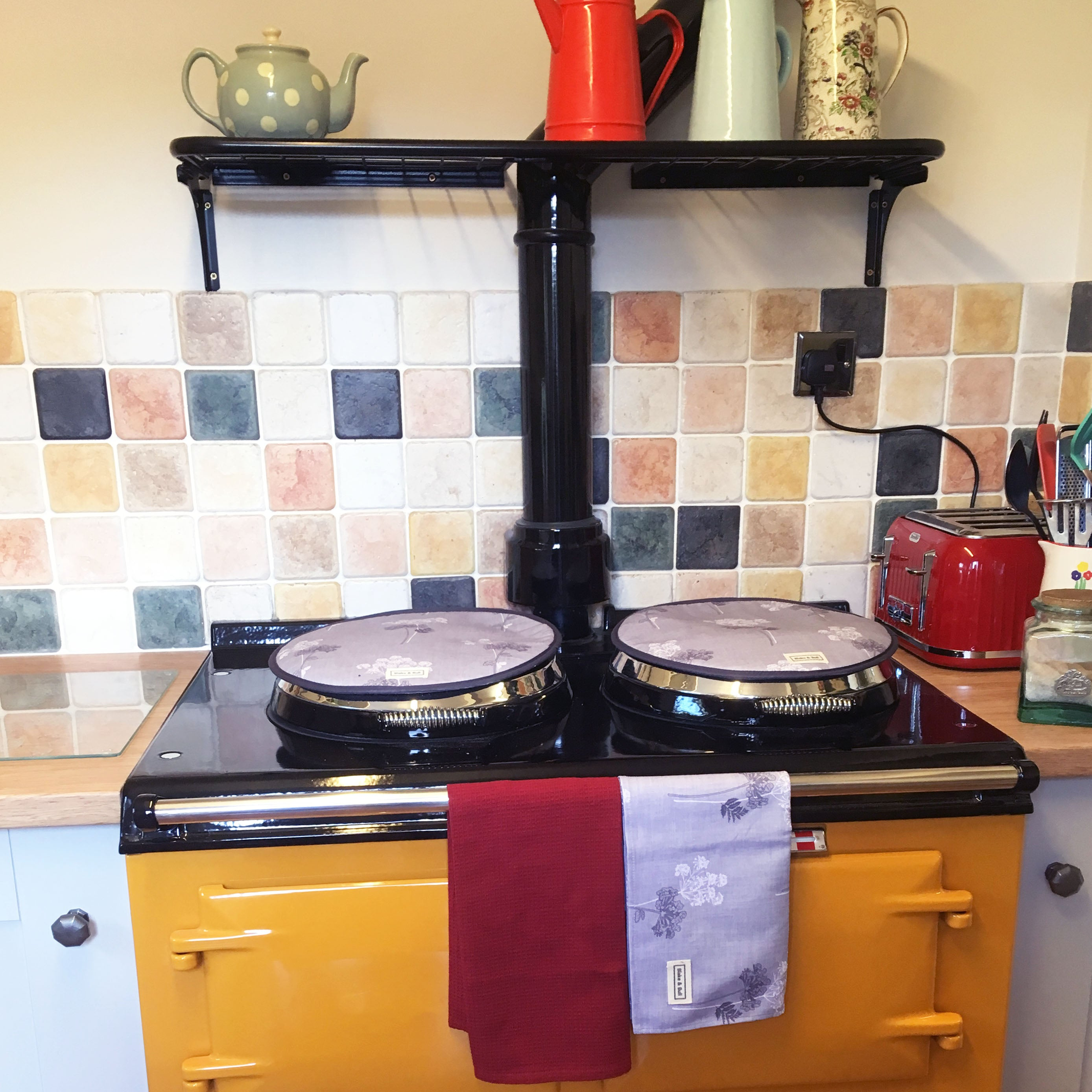 Wall rack for use with Aga range cooker